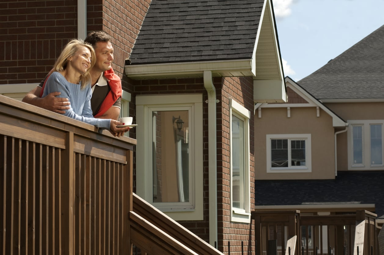 A young couple enjoying the view of the front porch of home